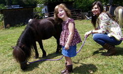 Two girls with minature horse